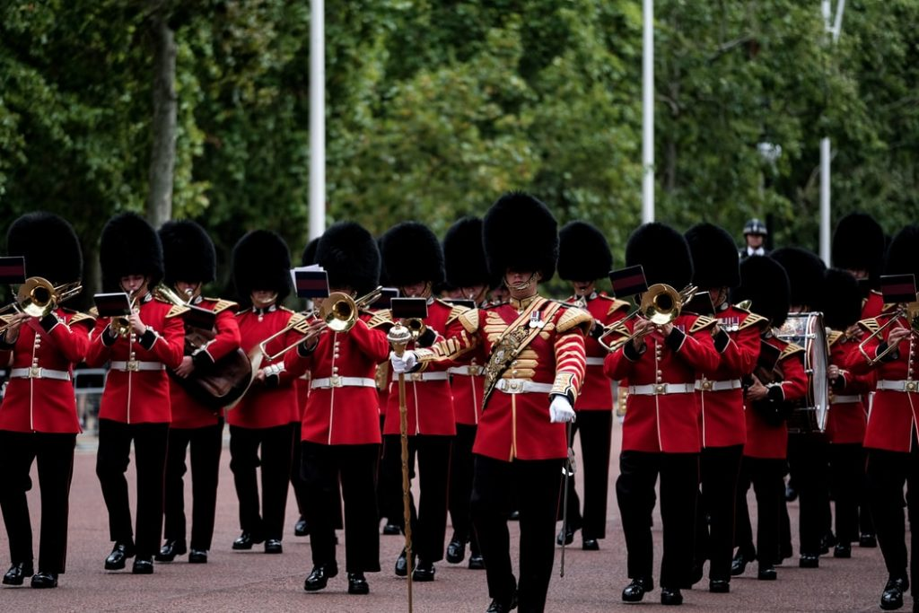 Royal guards from the army marching towards the Buckingham Palace​ in London.