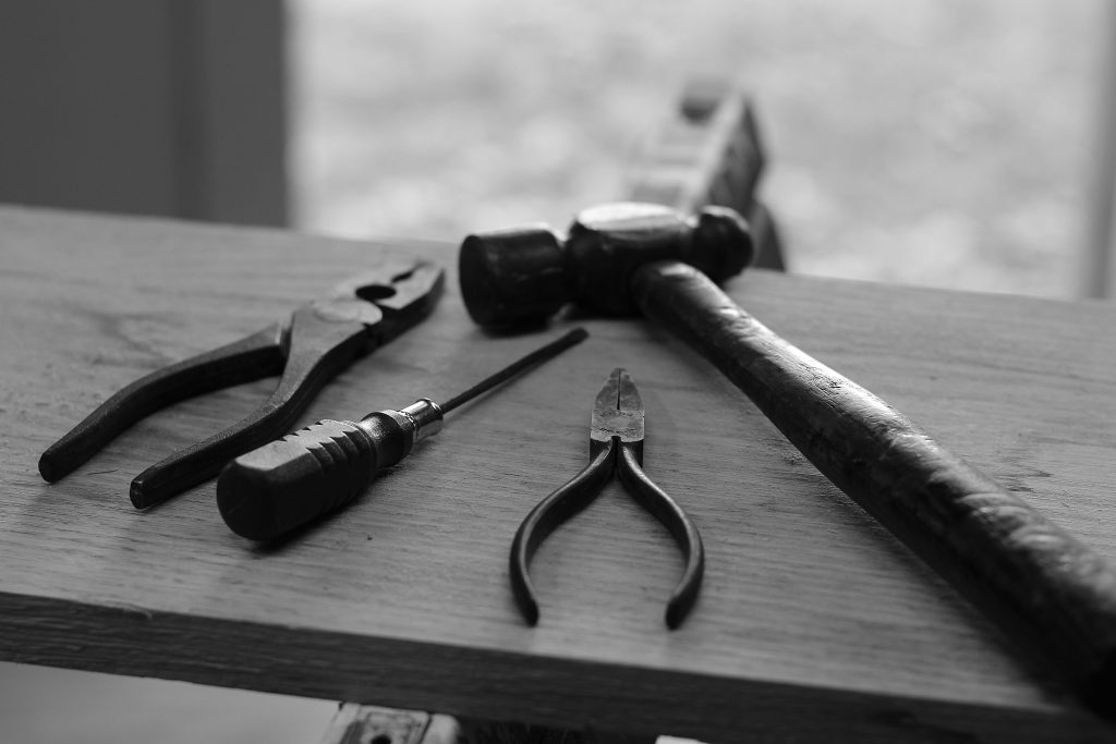 selection of tools on a work bench to repair marching band instruments