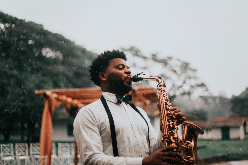 saxophonist playing in a park - keeping you and your instrument healthy