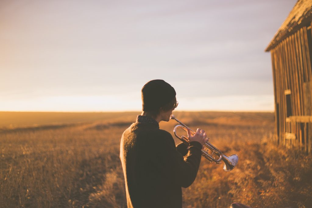 trumpeter in a field - keeping you and your instrument healthy
