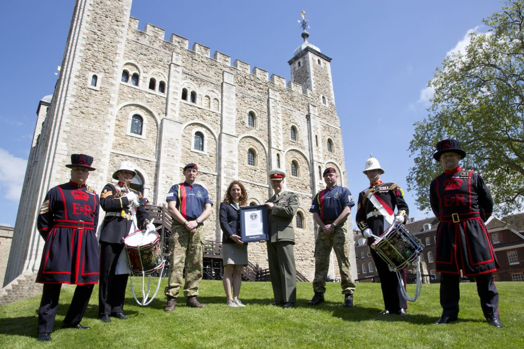 The Royal Marines Corps of Drums break the Guinness World Record for the longest group drum roll at the at the Tower of London