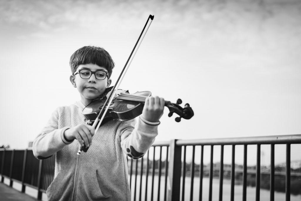 little boy playing musical instrument