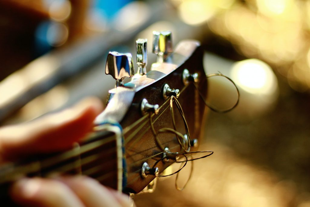 close-up of musical instrument and guitar strings