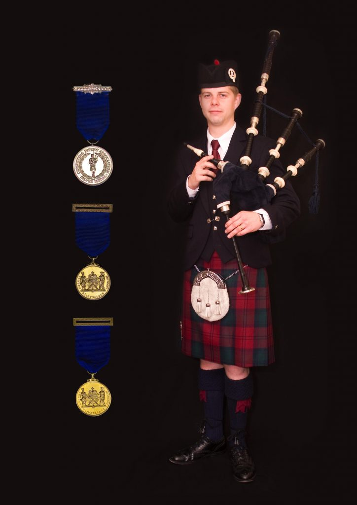 Alastair and his Competing Pipers Association medals [photo property of Alastair Dunn]