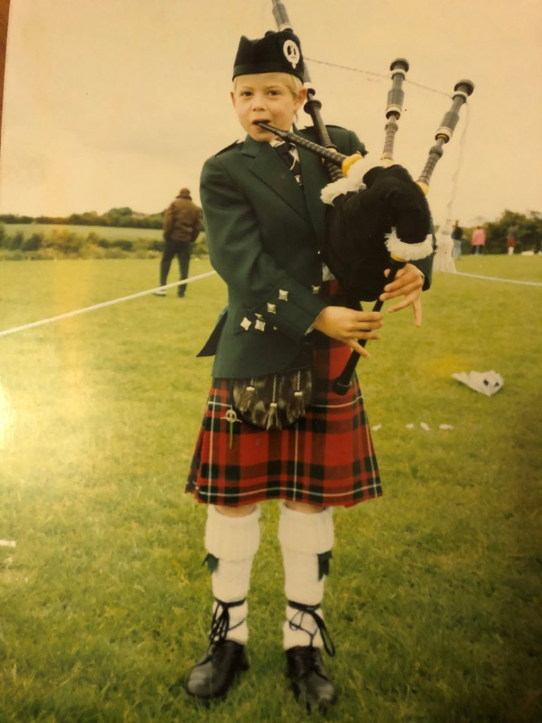 A young Alastair playing the bagpipes [photo property of Alastair Dunn]
