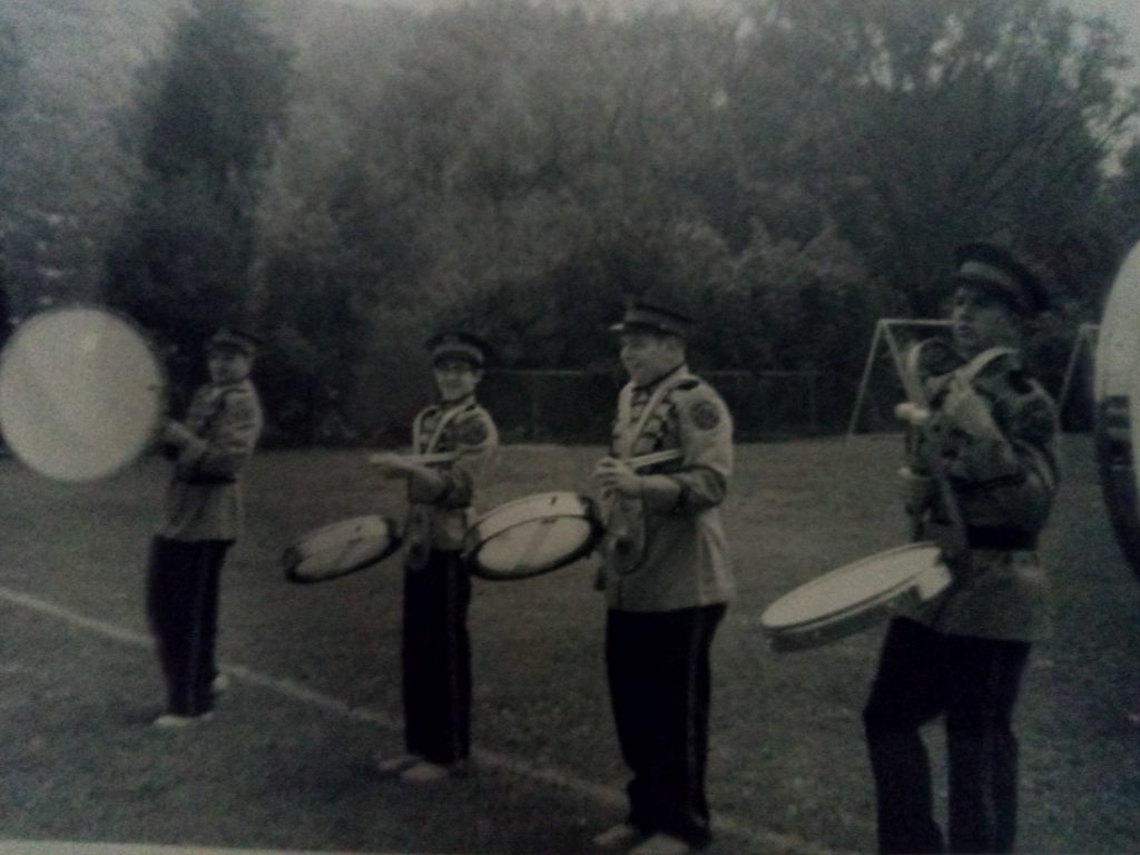 """Rex and his High School classmates with new Marching Band drums - Rogers """"Flat Jacks"""". The snare drums had two heads (1"""" apart), the tenor drums had one head, and the bass drums had one head which would spin around (photograph property of Rex Jamieson)"""