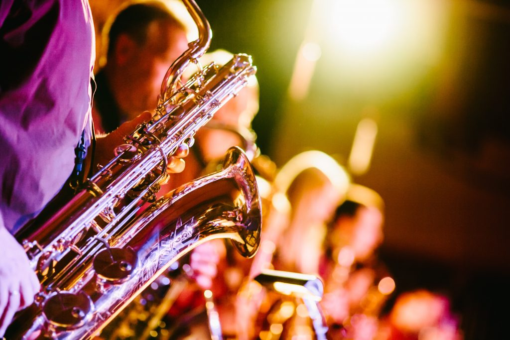 Woodwind instruments at a live music event (Photo by Jens Thekkeveettil on Unsplash)