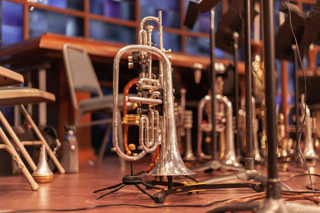 Brass instruments at a live music event (Photo by Lucas Alexander on Unsplash)