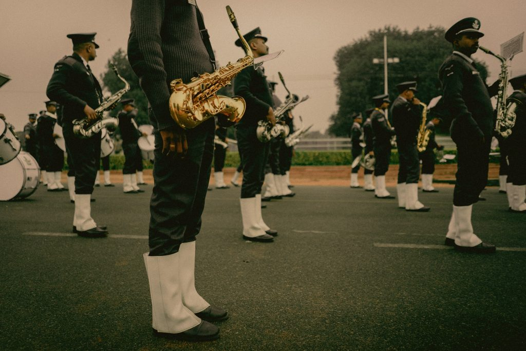 Marching band saxophonist in Delhi using a lyre [Photo by Dewang Gupta on Unsplash]