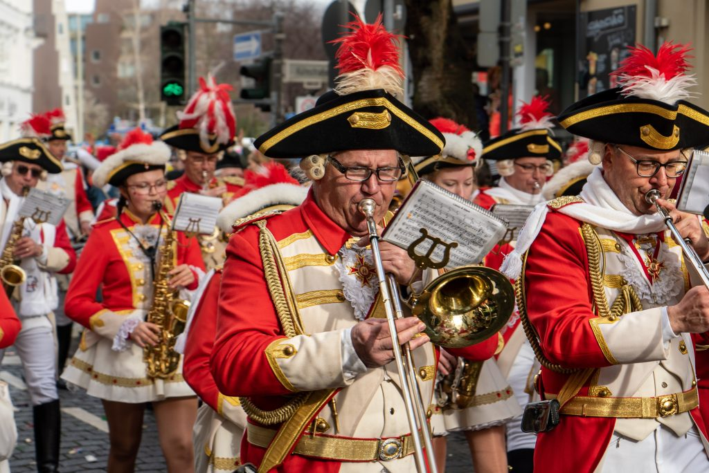 Marching band trombonist in Germany using a clamp-on bell lyre [Photo by Mika Baumeister on Unsplash]