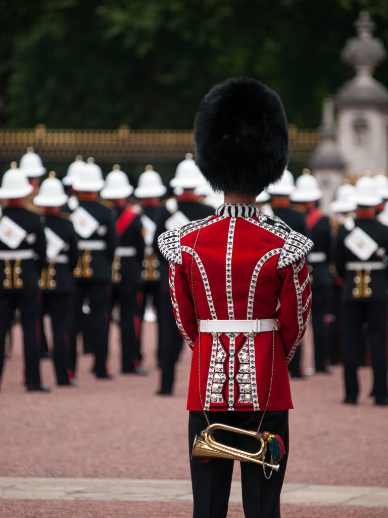 A Bugler from the Royal Marines Band at Changing of the Guard Ceremony at Buckingham Palace [Photo by William Warby on Unsplash]